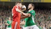 Shane Long (R) and Ben Davies battle for possession