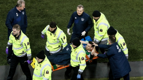 Seamus Coleman is comforted by assistant manger Roy Keane