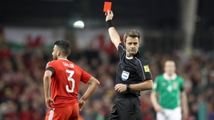 Neil Taylor is sent off by referee Nicola Rizzoli