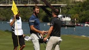 Dustin Johnson (L) shakes hands with Zach Johnson after his victory