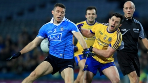 Dublin's Darren Daly with Ciaran Murtagh of Roscommon