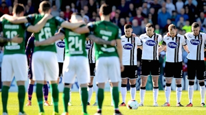 Cork City and Dundalk players observe a minute's silence for Ryan McBride