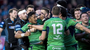 Glasgow's Finn Russell holds back Bundee Aki of Connacht as tempers flare