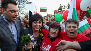 Kornelia Ninova (2L) poses with supporters during a pre-election rally in Sofia
