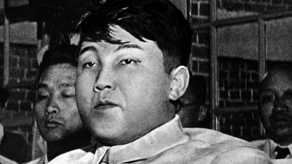 Kim il-Sung, born Kim Song Ju (1912 - 1994), Prime Minister of North Korea, pictured in 1955. Some 40 years later, his portrait emblazons an enormous drape outside an apartment in one of Bandi's stories.