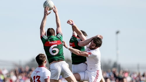 Ronan McNamee battles for possession against mayo's Lee Keegan