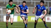 Cavan's Tomas Corr and Gerard Smith tackle Kerry's Jack Barry