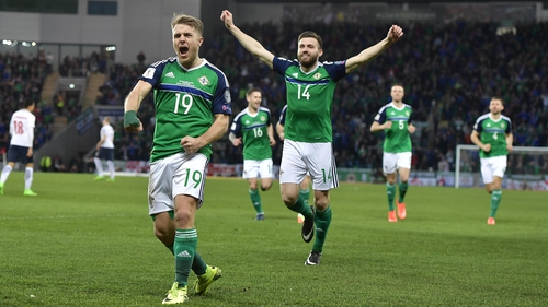 Jamie Ward (L) gave Northern Ireland the lead in the second minute