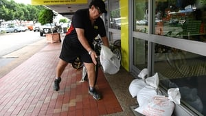 A Business owner sandbags his shop near Townsville in preparation for Cyclone Debbie