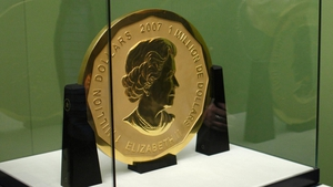 The coin features Britain's Queen Elizabeth