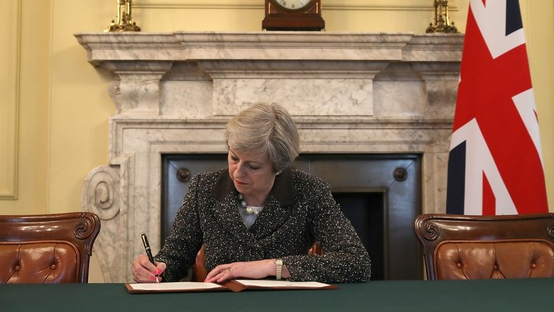 Image result for Theresa May signs Brexit letter to EU, Britain's envoy Tim Barrow will deliver the letter to E.U.