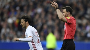 Referee Felix Swayer asks for video assistance