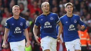 Phil Jagielka (C) celebrates with James McCarthy and John Stones after scoring a late leveller at Anfield in 2014