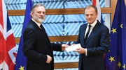 European Council President Donald Tusk being handed the letter by UK permanent representative Tim Barrow in Brussels