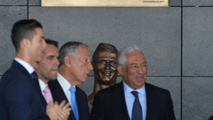 Ronaldo puts on a brave face as the statue of him is unveiled at the airport renaming