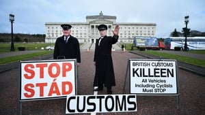 Two men dressed as customs officers take part in a protest outside Stormont against Brexit