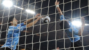 Luis Suarez (l) helped Uruguay qualify for the semi-finals of the World Cup in 2010 with this save