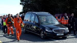The body of Captain Mark Duffy was accompanied by a guard of honour as it was driven along the seafront at Blacksod Co Mayo