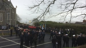 Crowds gather at St Oliver Plunkett Church in Blackrock, Co Louth before the funeral