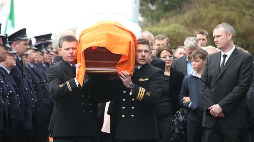 Captain Mark Duffy's remains are carried into the church