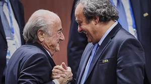 Michel Platini (R) has taken a swipe at Sepp Blatter