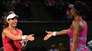 Johanna Konta is congratulated by Venus Williams at the end