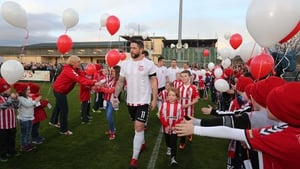 Derry City younger players and fans formed a guard of honour for the team as they arrived on the pitch