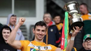 Antrim's Simon McCrory lifts the Division 2A trophy after victory in News