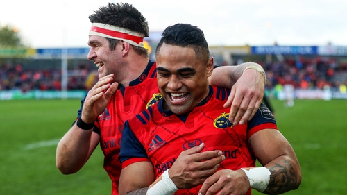 Billy Holland celebrates with Francis Saili at Thomond Park