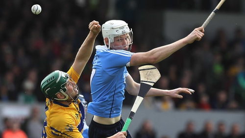 The ball evades both Cathal McInerney and Shane Barrett