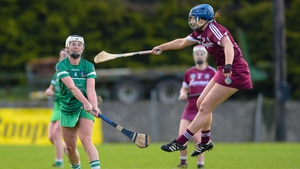 Galway's Derevala Higgins battles for possession against Limerick's Fiona Hayes