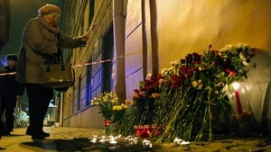 Flowers and candles were laid outside the metro station in Saint Petersburg