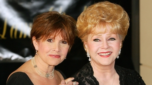Debbie Reynolds', pictured here with daughter Carrie Fisher, iconic costumes to go on display