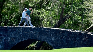 Rory McIlroy continues his quest for the green jacket