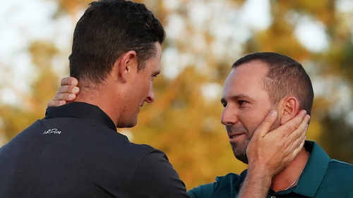 Rose (left) congratulates Garcia after their extra hole at Augusta National