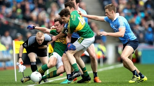 Kerry and Dublin players tussle along the sideline at Croke Park