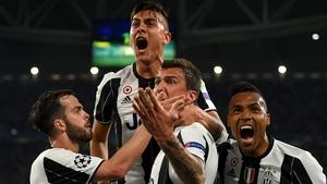 Juventus striker Paulo Dybala celebrates with Miralem Pjanic, Mario Mandzukic and Alex Sandro