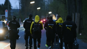 Borussia Dortmund players are escorted by police after the bus attack