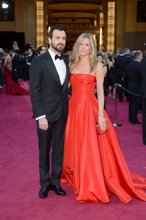 Hollywood chic at its best! The couple was attending the Oscars ceremony in 2013 in a Salvatore Ferragamo suit for him, and in a princess Valentino gown for her.