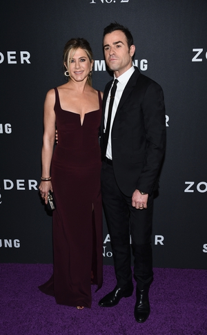 Galvan burgundy dress and Valentino suit is the perfect combo for the couple at the 'Zoolander 2' World Premiere in 2016!