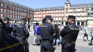 Videos posted on social media show football fans gathered in a litter-strewn square and officers in riot gear