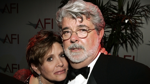 """Carrie Fisher and George Lucas (pictured in 2005) - """"We'll all love her forever and ever"""""""