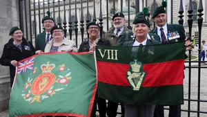 Veterans hold flags outside Belfast City Hall