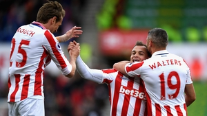 Xherdan Shaqiri is congratulated by Peter Crouch and Jonathan Walters