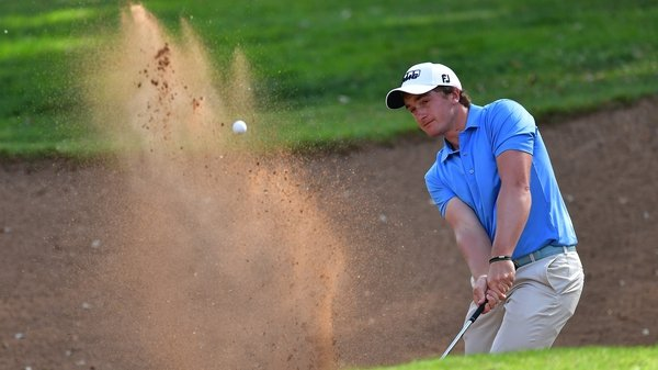 Paul Dunne escapes a bunker during the third round