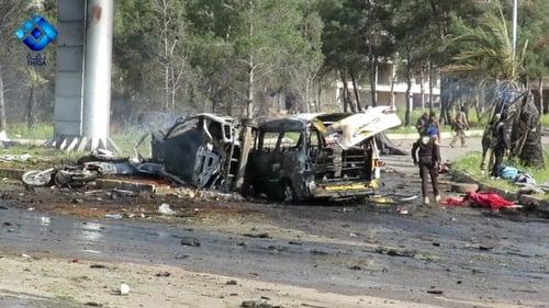 Rescue and media personnel at the scene of the car bomb attack in Rashidin, west of Aleppo
