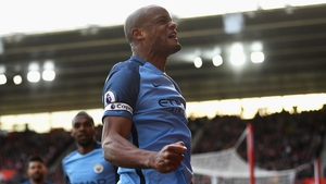 Vincent Kompany celebrates his opener in front of the City fans
