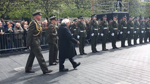 President Michael D Higgins inspects an honour guard