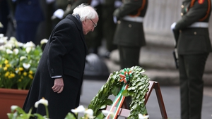 After President Michael D Higgins laid the laurel wreath, a minute's silence was held and the Last Post was played