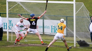 Antrim's Neill McManus scores his side's second goal